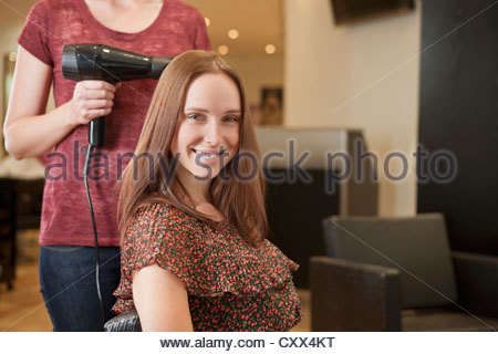 A female client showing off her new haircut - Stock Photo