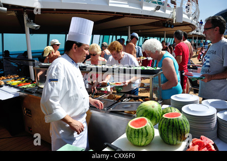 Chef serving lunch on deck of Royal Caribbean 'Grandeur of the Seas' cruise ship, Adriatic Sea, Mediterranean, Europe - Stock Photo
