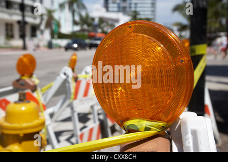 yellow beacon light on edge of construction work roadside miami south beach florida usa - Stock Photo