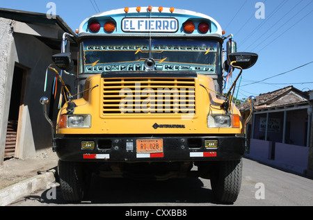 Decorated local bus (chicken bus) at Moyogalpa, Ometepe Island, Nicaragua Central America - Stock Photo