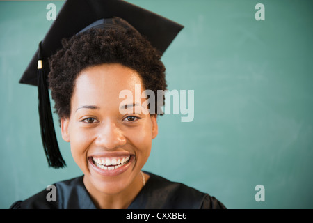 African American woman in graduation cap and gown