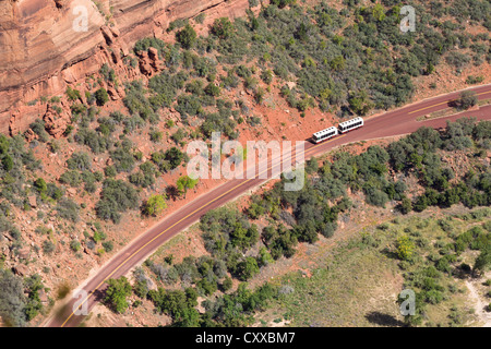 View from a top of Angels Landing -  looking down the Zion Canyon - Shuttle / bus driving on along the Floor of - Stock Photo