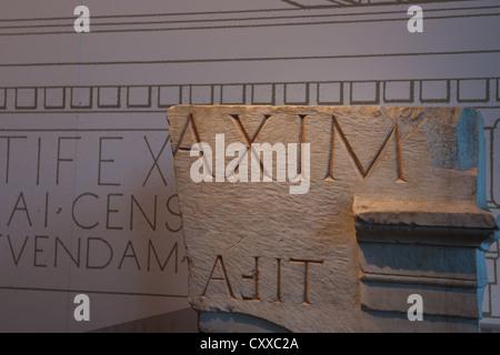 Roman inscription, carved in stone. - Stock Photo