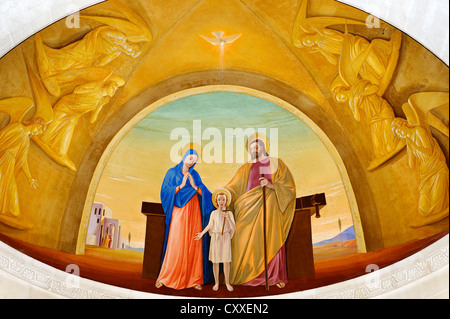 Mary, Joseph and Baby Jesus, fresco above the high altar in St. Joseph's Church, Nazareth, Galilee, Israel, Middle - Stock Photo