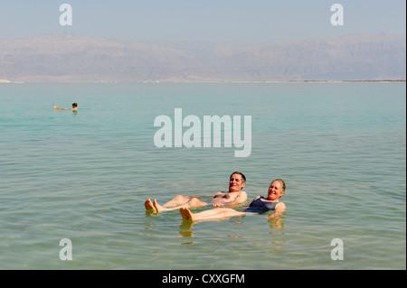 Bathing, swimming tourists in Ein Bokek, En Boqeq, Dead Sea, Israel, Middle East - Stock Photo