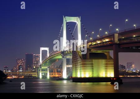 one of famous Tokyo landmarks, Tokyo Rainbow bridge over bay waters with scenic night illumination - Stock Photo