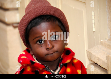 Little Indian boy, temple servant, portrait, temple near Jaisalmer, Rajasthan, northern India, Asia - Stock Photo