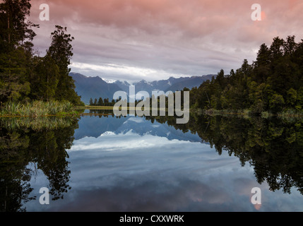 Mt. Tasman and Mt. Cook, Aoraki, reflection in Lake Matheson, Mt. Cook National Park, Westland National Park, Southern - Stock Photo
