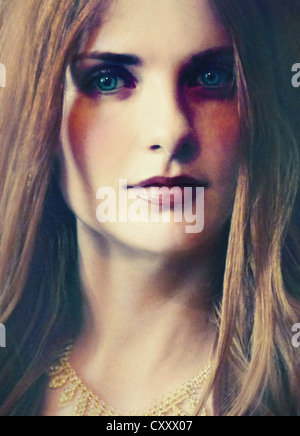 A portrait of a woman with blonde hair and deep-blue eyes, curious look and a gold classic necklace. - Stock Photo