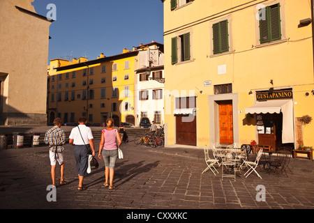 Tourists walking in Piazza Santo Spirito, Florence.