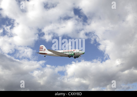 Aircraft, lettering 'Fly with me', clouds, sky - Stock Photo