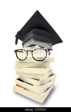 Stack of books with a graduation cap and a pair of glasses - Stock Photo