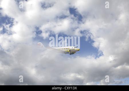 Aircraft, clouds, sky - Stock Photo