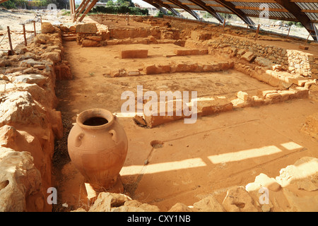 Excavations of archaeological remains of Minoan Palace and City of Malia Crete Greece - Stock Photo