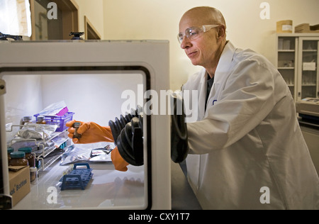 A chemist dressed in safety gear works in research at a at a pharmacutical research laboratory near Bend, Oregon. - Stock Photo