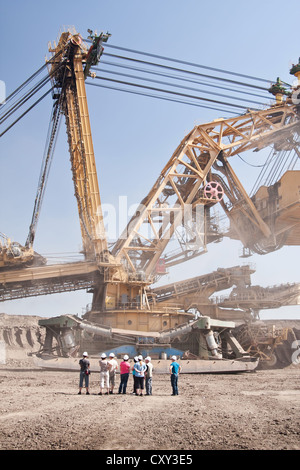 the people by extractive machine in coal opencast - Most - Czech Republic - Stock Photo
