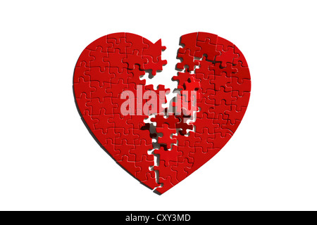 Red heart-shaped jigsaw puzzle, torn in half - Stock Photo
