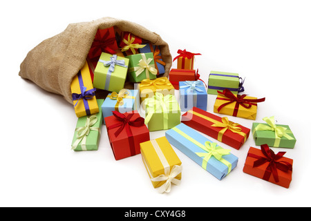 Christms sack filled with Christmas gifts - Stock Photo
