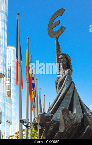 Europa holding a Euro symbol, outside the offices of the European Parliament, Brussels, Belgium (European flags - Stock Photo
