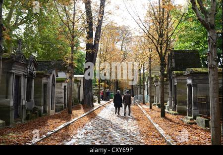 Père Lachaise Cemetery, tourists visiting the Pere Lachaise Cemetery, Cimetière du Père-Lachaise, Paris, France - Stock Photo