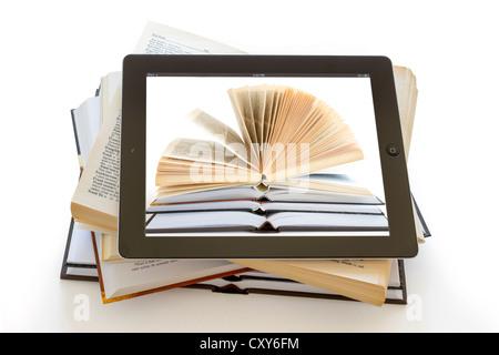Ipad 3 with books background on opened books on white background - Stock Photo