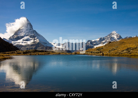 Matterhorn reflected in the Riffelsee alpine lake - Stock Photo