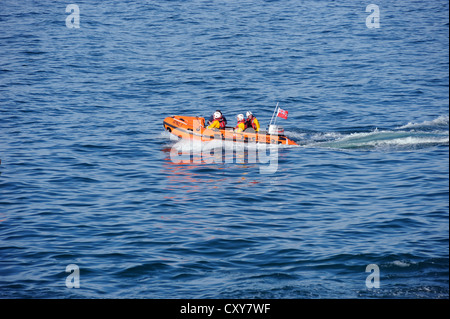 RNLI lifeboat in a calm sea - Stock Photo