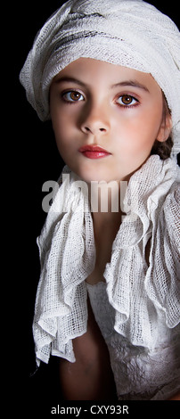 Young girl wearing head scarf. - Stock Photo