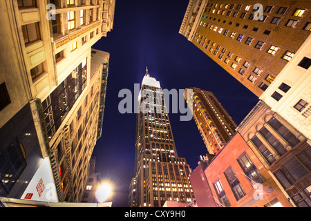 NEW YORK CITY - SEPT 13: Landmark Empire State and surrounding buildings in midtown Manhattan on night of Sept. - Stock Photo