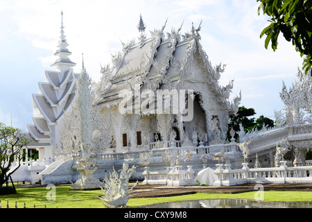 The beautiful Wat Rong Khun ( White Temple) near Chiang Rai, Thailand. - Stock Photo