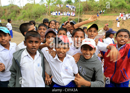 Schoolchildren at Demodara train station near Ella in the Sri Lanka highlands. - Stock Photo