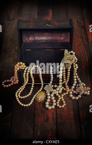 a treasure chest full of jewelry - Stock Photo