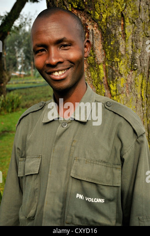 Park guide at the entrance to the Volcanoes National Park, Parc National des Volcans near the village of Kinigi, - Stock Photo