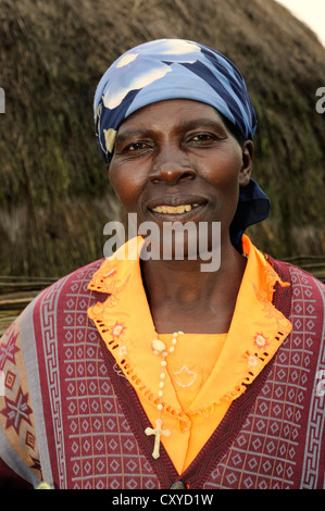 Indigenous woman in the village of Kinigi on the edge of the Volcanoes National Park, Parc National des Volcans, - Stock Photo