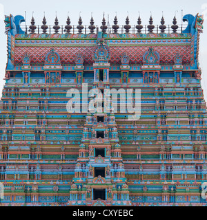 Top Of One Colorful Gopuram With Numerous Carved Figurines At The Sri Ranganathaswamy Temple, Trichy, India - Stock Photo
