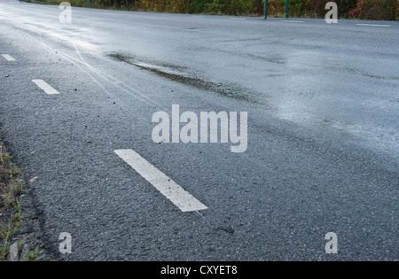Treacherous road due to rain or frost - Stock Photo