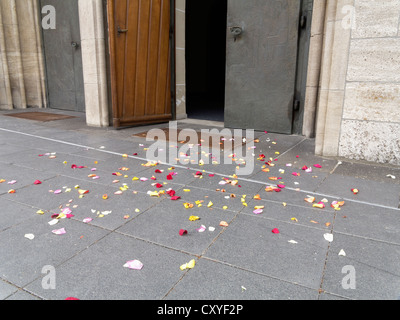 Rose petals on the ground after a wedding, in front of Agneskirche church, Hamm, North Rhine-Westphalia, PublicGround - Stock Photo