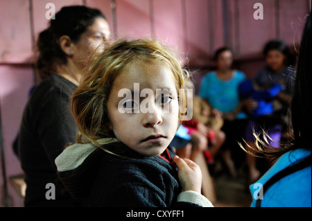 Girl during a meeting of an aid organisation that provides health services and information for mothers and children, - Stock Photo