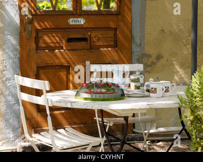 Summerly, decoratively laid coffee table - Stock Photo