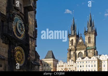 Prazsky orloj, the astronomical clock of Prague's town hall, with the towers of Tynsky chram, the Tyn Church, Prague - Stock Photo