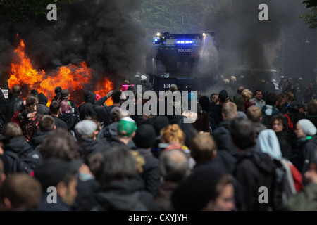Use of water cannon against anti-Nazi protesters, the left-wing protesters tried to stop a rally of neo-Nazis with - Stock Photo