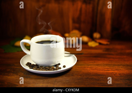 A steaming cup of coffee. - Stock Photo