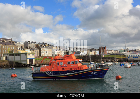 RNLI Lifeboat station and RNLB William Gordon Burr moored in harbour at Portrush, Co Antrim, Northern Ireland, UK - Stock Photo