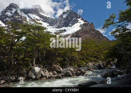 Glacial river in the French Valley, view of the snow-capped Cordilera Paine Grande mountain, Torres del Paine National - Stock Photo
