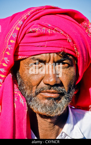 Man with a red scarf, portrait, Mandvi , Bhuj, India, Asia - Stock Photo