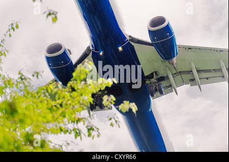 A passenger plane on landing approach, from below, Duesseldorf, North Rhine-Westphalia