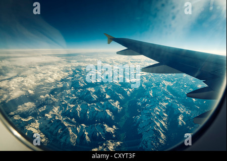 View of the wing of the plane and the Alps, Croatia, Europe - Stock Photo