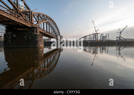 Deutschherrnbruecke bridge near Frankfurt am Main, from the southern bank of the Main river with the construction - Stock Photo