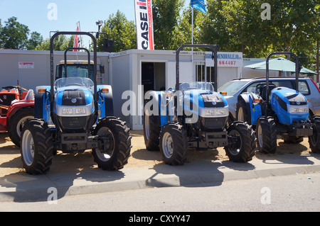 the fair International Livestock agro-industrial exhibition, transportation Vintage Farm Tractors at county fair - Stock Photo