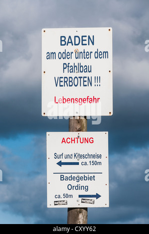 Warning sign, no swimming, a beach on the North Sea, St. Peter-Ording, in Schleswig-Holstein - Stock Photo
